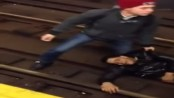 man high on drugs lays on train tracks