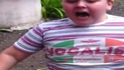 Chubby kid scared of dog